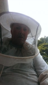Robert D Johnson in bee veil.
